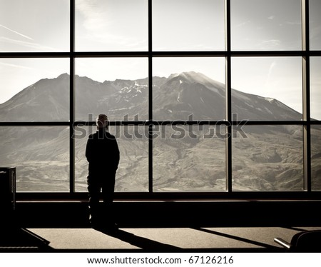 View of Woman Looking at Volcano (Mount Saint Helens) - stock photo
