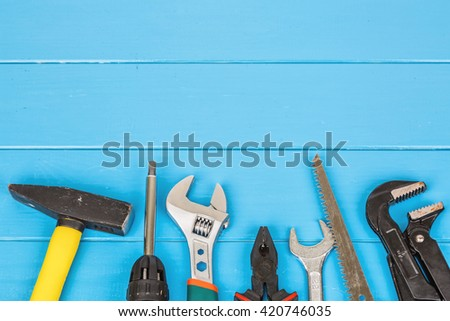 View of work tools on blue wooden background - stock photo
