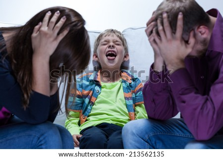 View of yelling boy with educational problems - stock photo