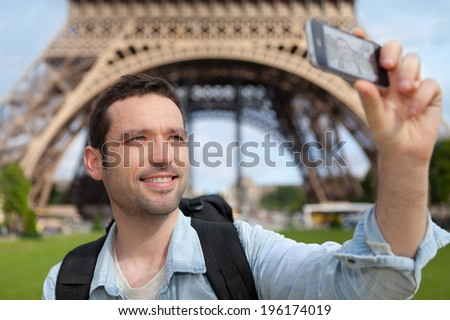 View of Young attractive tourist taking selfie in Paris - stock photo