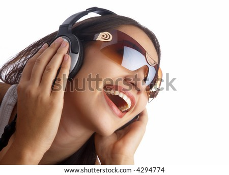 view of young nice girl listening music via earphones