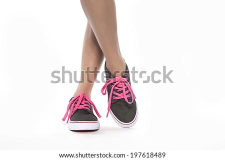 View of young women feet wearing shoes - stock photo