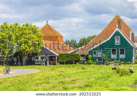 View of Zaanse Schans - museum village in Zaandam with dutch houses and wind mills. The Netherlands. - stock photo