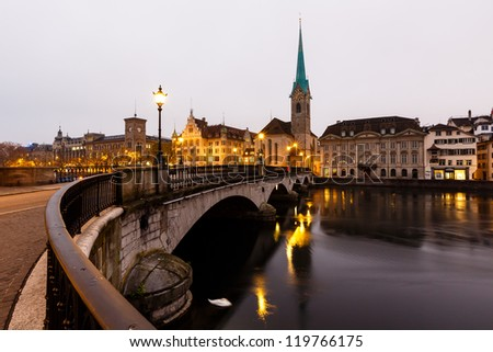View of Zurich and Old City Center Reflecting in the river Limmat at Morning, Switzerland - stock photo