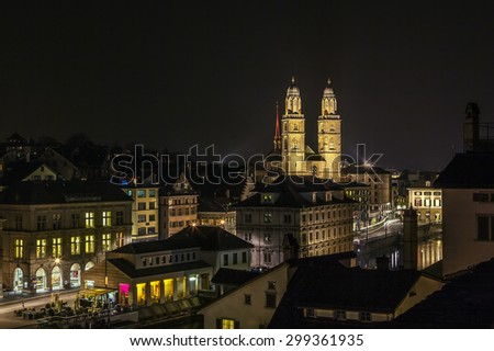 view of Zurich with Grossmunster church from the Lindenhof hill in evening, Switzerland - stock photo