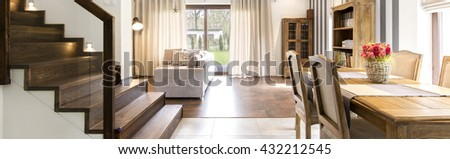 View on a bright living room and cozy dining area - stock photo