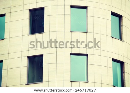 View on a building for offices, with greeny windows. Part of the building. - stock photo