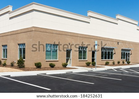 View on a generic small office building exterior with parking lot - stock photo