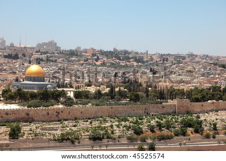 View on a gold dome of a mosque and a fortification of Jerusalem from a cemetery