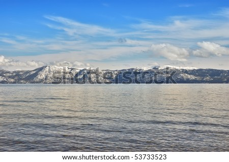 View on a lake Tahoe lit by afternoon sun in winter.