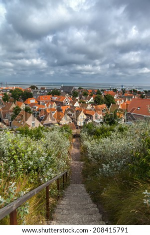 View on a small village on the island Terschelling in the Netherlands  - stock photo
