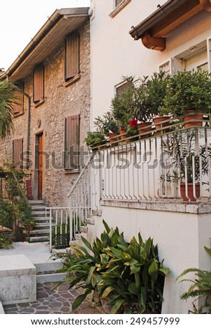 View on a traditional italian yard with terrase and plants.