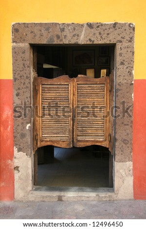 View on a typical urban scene with colorful folding door in old saloon. Guadalajara. Mexico