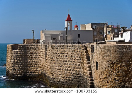 View on Acre (Akko) Ancient City Walls with lighthouse, Israel - stock photo