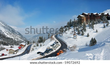 View on an alpine skiing resort. Winter vacation. French Alps