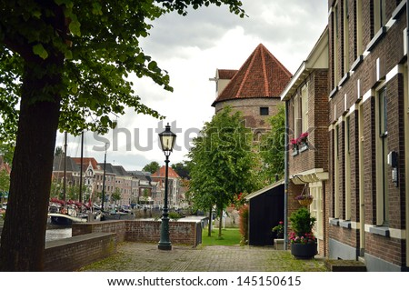 View on an ancient tower and canal in Zwolle, The Netherlands - stock photo