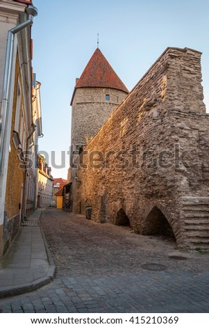 View on ancient street with medieval wall of Tallinn, Estonia - stock photo