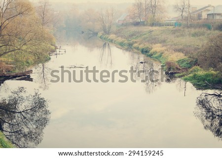 View on autumn landscape of river and trees