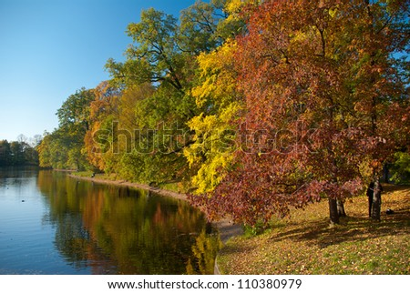 View on autumn landscape of river and trees in sunny day - stock photo