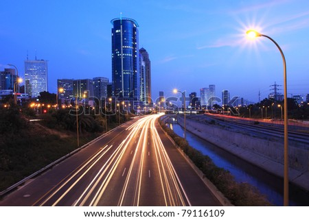 View on Ayalon freeway and modern building at evening in Tel-Aviv, Israel.