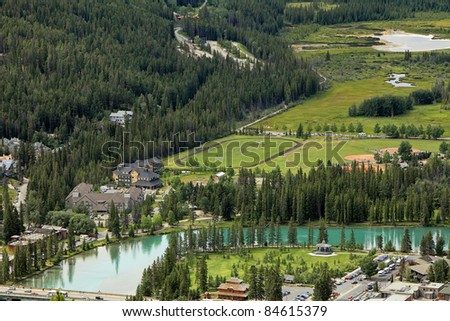 View on Banff city and Bow river from height of the bird's flight (Banff National Park, Alberta, Canada)