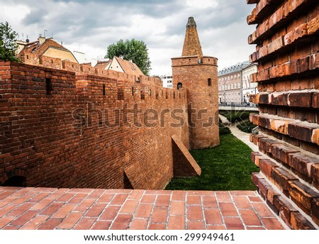 view on Barbakan walls and towers in Warsaw in Poland - stock photo