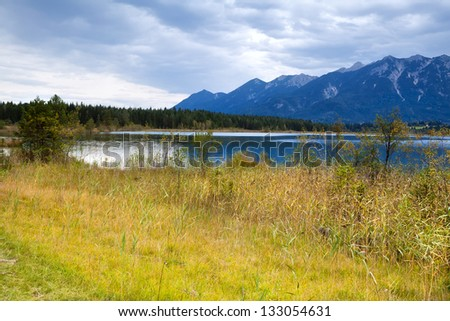 view on Barmsee lake in Bavarian Alps during clouded day