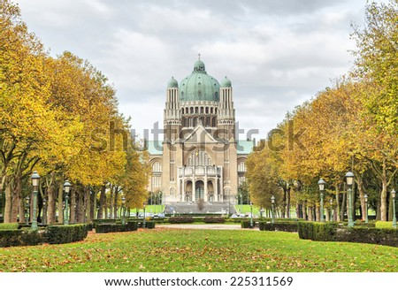 View on Basilica of Sacred Heart from Elisabeth Park with yellow thees, Brussels, Belgium - stock photo