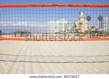 View on beaches of Tel Aviv through a volleyball net - stock photo