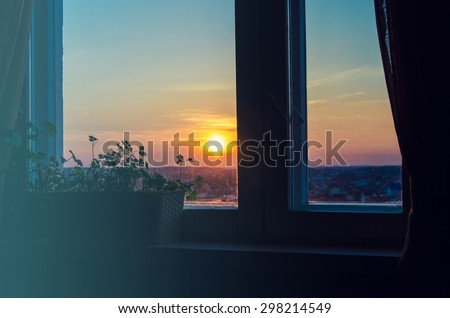 View on beautiful sunrise from home window - stock photo