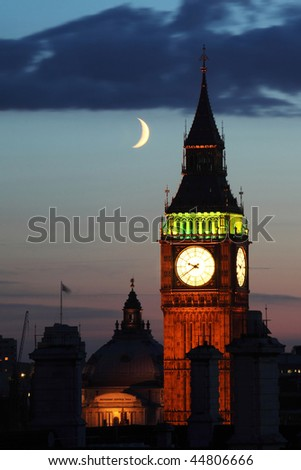 view on big ben and the moon by night - stock photo
