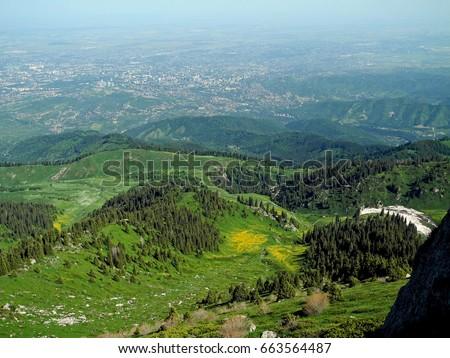 View on big city (Almaty, Kazakhstan) from big mountain