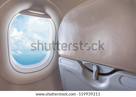 View on blue sky from airplane passenger window