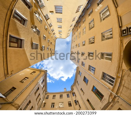 view on blue sky from  well yard, Moscow, Russia - stock photo