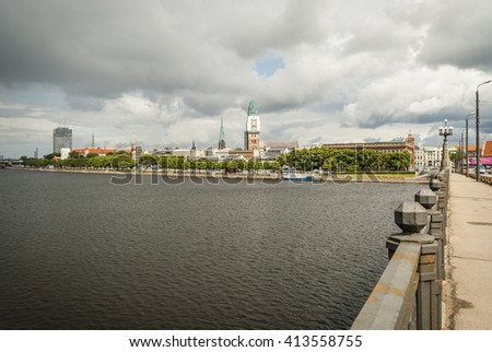 View on bridge over river against of cityscape of Riga, Latvia - stock photo