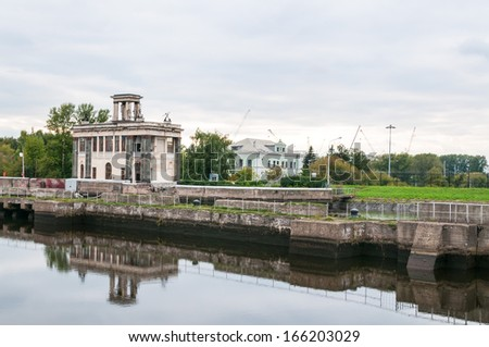 View on canal bank and sluice building against cloudy sky background. Moscow, Russia.