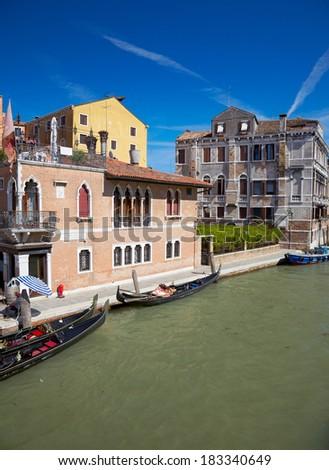View on Canal Cannaregio from Guglie bridge ( Ponte delle Guglie ) in Venice, Italia - stock photo