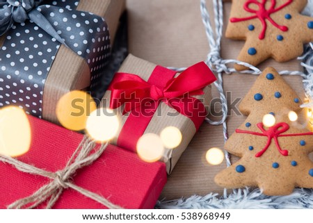 View on Christmas gifts on fur background