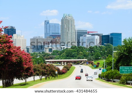 View on city of Raleigh, the capital of the state of North Carolina - July 2015. New building additions to Raleigh's skyline. Raleigh is highly ranked as one of the best places to live in the U.S. - stock photo