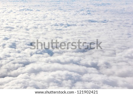 View on clouds from the airplane window - stock photo