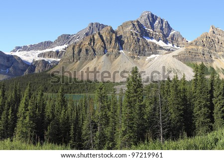 View on coniferous woods and Rocky mountains of Canada - stock photo