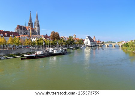 View on Danube river in Regensburg with Regensburg Cathedral, Tower of Town Hall, Salt House and Stone Bridge, Germany - stock photo
