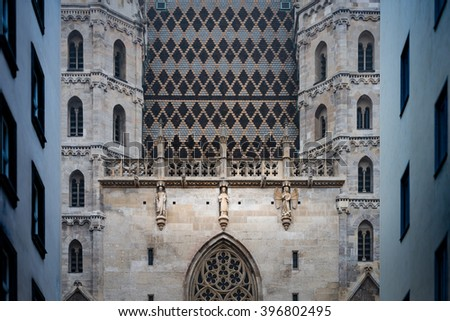 View on details of St. Stephen cathedral and residential houses in Vienna old town, Austria. Europe travel. - stock photo