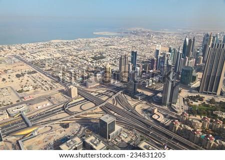 View on Downtown Dubai from the viewing platform in the Burj Khalifa Dubai, United Arab Emirates. - stock photo