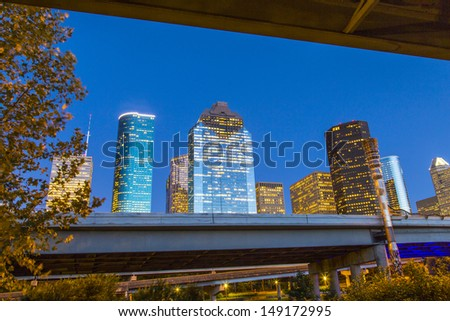 View on downtown Houston by night with skyscraper - stock photo