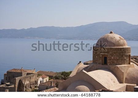 View on downtown Monemvasia at the Greek Peloponnese, church - stock photo