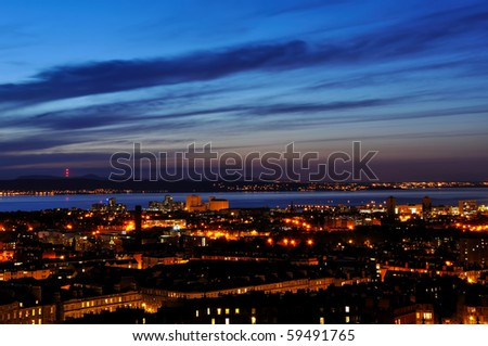 View on Edinburgh city and harbor in night from Nationl Monument, Scotland - stock photo