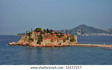 View on fantastic island Sveti Stefan. Montenegro.  Flying weather. - stock photo