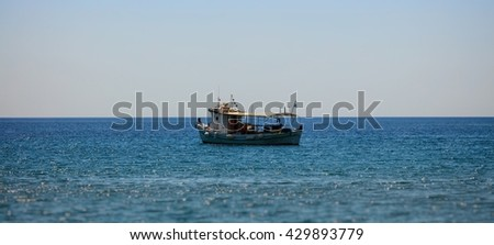 View on fisher boat on sea against of blue sky