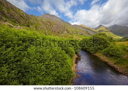 view on Five Sisters of Kintail from Shiel Bridge, Glen Shiel, Scotland - stock photo